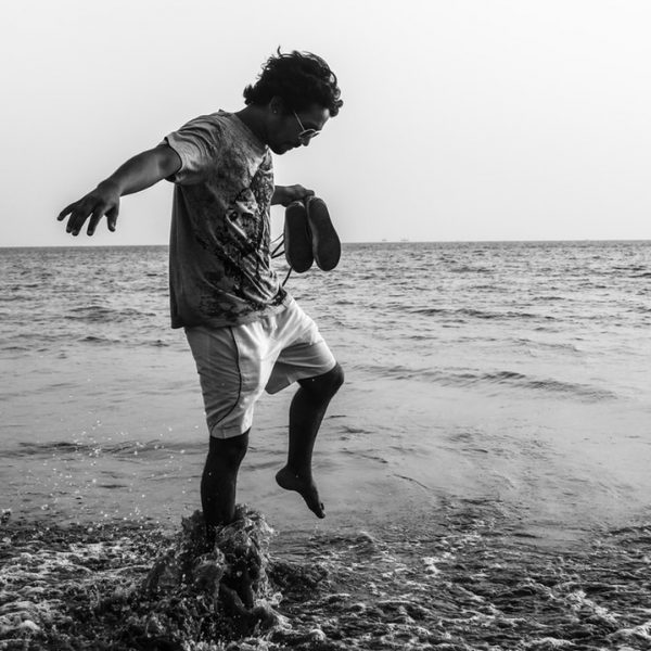 thumbnails/man-on-top-of-body-of-water-grayscale-photography-1356286.jpg