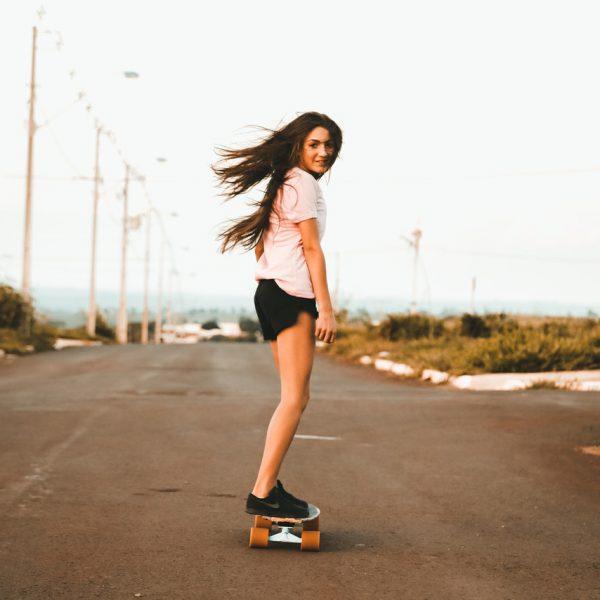 thumbnails/woman-riding-skateboard-at-the-road-1250643.jpg